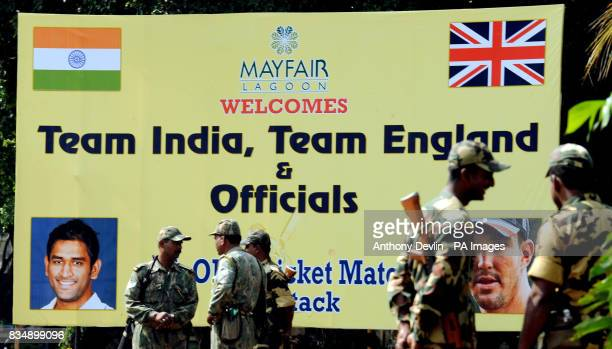 Armed guards patrol the main entrance to the Mayfair Hotel where the England cricket team are staying in Bhubaneswar India