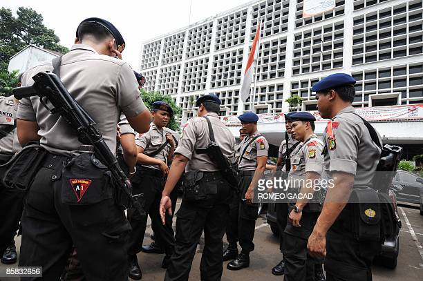 Armed Indonesian police secure the headquarters of the Election Commission Office in Jakarta on April 7 2009 as the country prepares for the April 9...