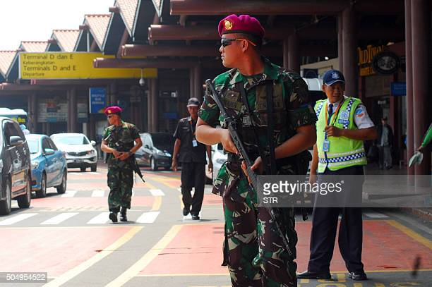 Armed Indonesian soldiers secure the SoekarnoHatta airport in Tangerang outside Jakarta on January 14 following bomb attacks by militants in central...