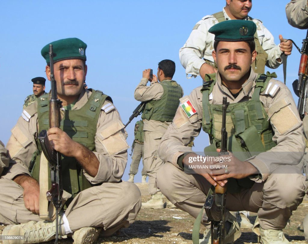 Armed Iraqi Kurdish peshmerga fighters hold a post in the mountains between the towns of Tuz Khurmatu and Khanaqin, on the border of the Diyala and Sulaimaniya provinces, on November 22, 2012. Iraq's parliament speaker pushed to ease Arab-Kurd tensions on a visit to Iraqi Kurdistan, as the two sides traded accusations about reinforcements being sent to disputed areas. Tensions are high in areas of northern Iraq that the autonomous Kurdish region wants to incorporate over the strong objections of Baghdad, and there is a threat of conflict between Arab and Kurdish security forces.