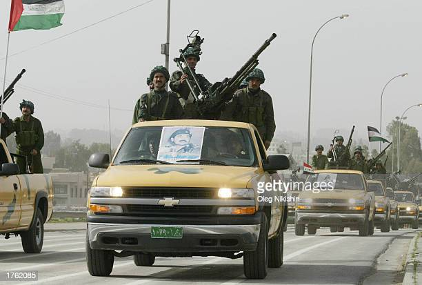 Armed Iraqi men ride cars during a parade in Mosul north of Baghdad February 4 2003 Thousands of armed volunteers paraded in northern Iraq in...