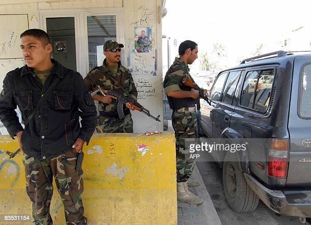 Armed Iraqi militiamen members of the Sahwa militias former Sunni insurgents who have switched to backing the United States man a checkpoint in the...