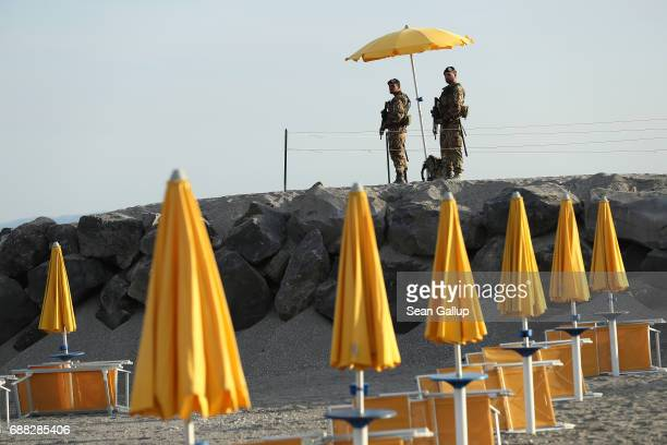 Armed Italian soldiers stand at the beach near the media center for the G7 Taormina summit on the island of Sicily on May 25 2017 in Giardini Naxos...