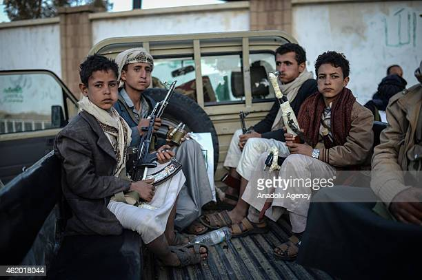 Armed kids are seen as thousands of Yemeni Shiite Houthi followers take part in a protest in Sana'a Yemen on January 23 2015 against cartoons by a...