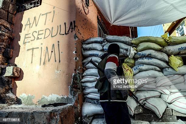 A armed kurdish millitant stands behind a barricade on November 18 2015 at Sur district in Diyarbakir Tensions rose when proKurdish MP Leyla Zana...