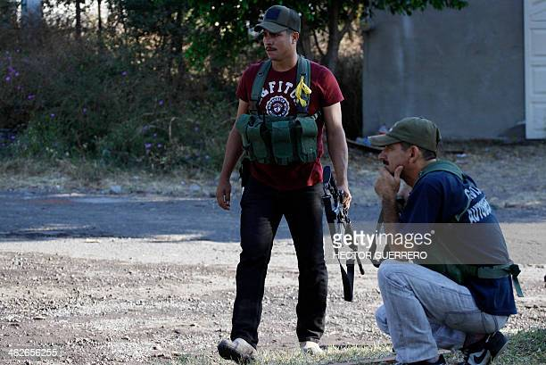 Armed members of the citizens' SelfProtection Police stand guard in Paracuaro community Michoacan State Mexico on January 14 2014 Deadly armed...