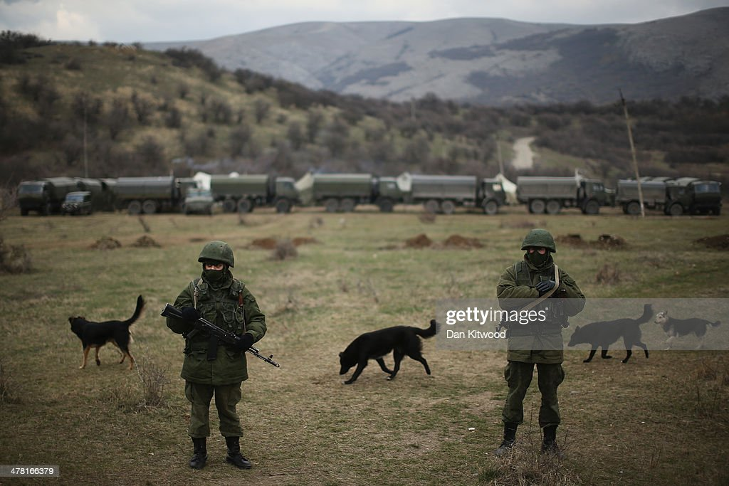 Armed men believed to be Russian military patrol outside a Ukrainian military base on March 12, 2014 in Simferopol, Ukraine. As the standoff between the Russian military and Ukrainian forces continues in Ukraine's Crimean peninsula, world leaders are pushing for a diplomatic solution to the escalating situation. Crimean citizens will vote in a referendum on 16 March on whether to become part of the Russian federation.