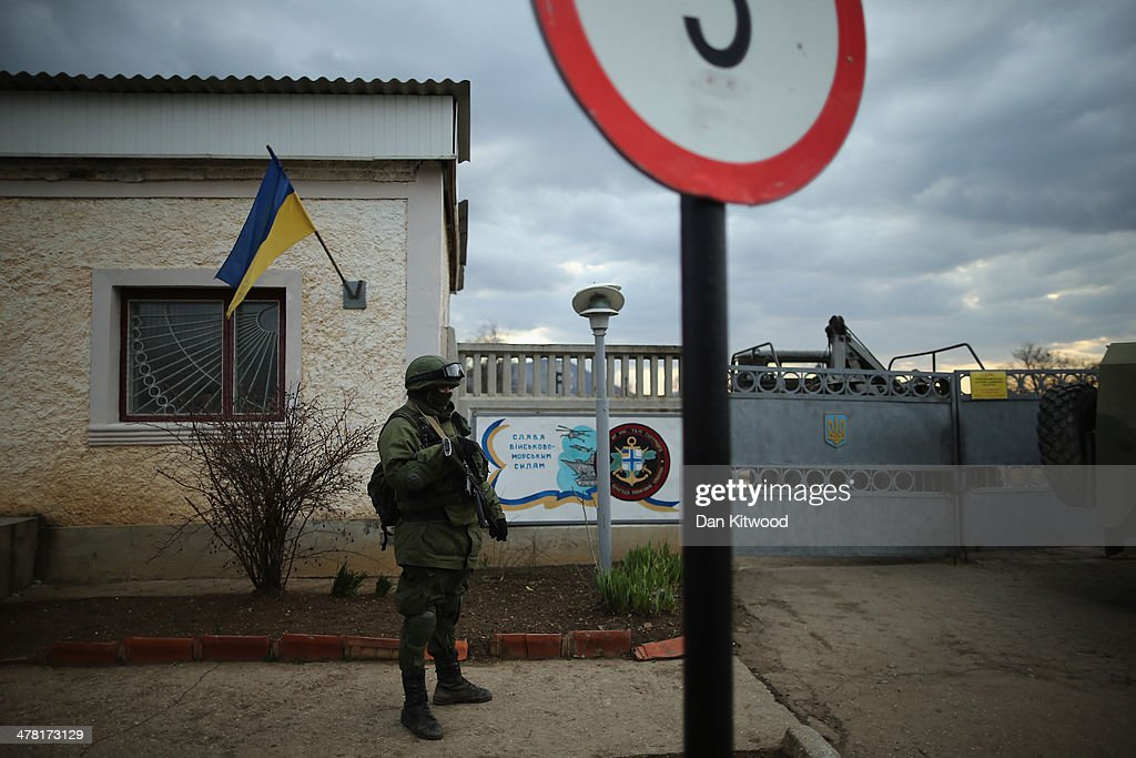 Armed men believed to be Russian military stand outside a Ukrainian military base on March 12, 2014 in Simferopol, Ukraine. As the standoff between the Russian military and Ukrainian forces continues in Ukraine's Crimean peninsula, world leaders are pushing for a diplomatic solution to the escalating situation. Crimean citizens will vote in a referendum on 16 March on whether to become part of the Russian federation.