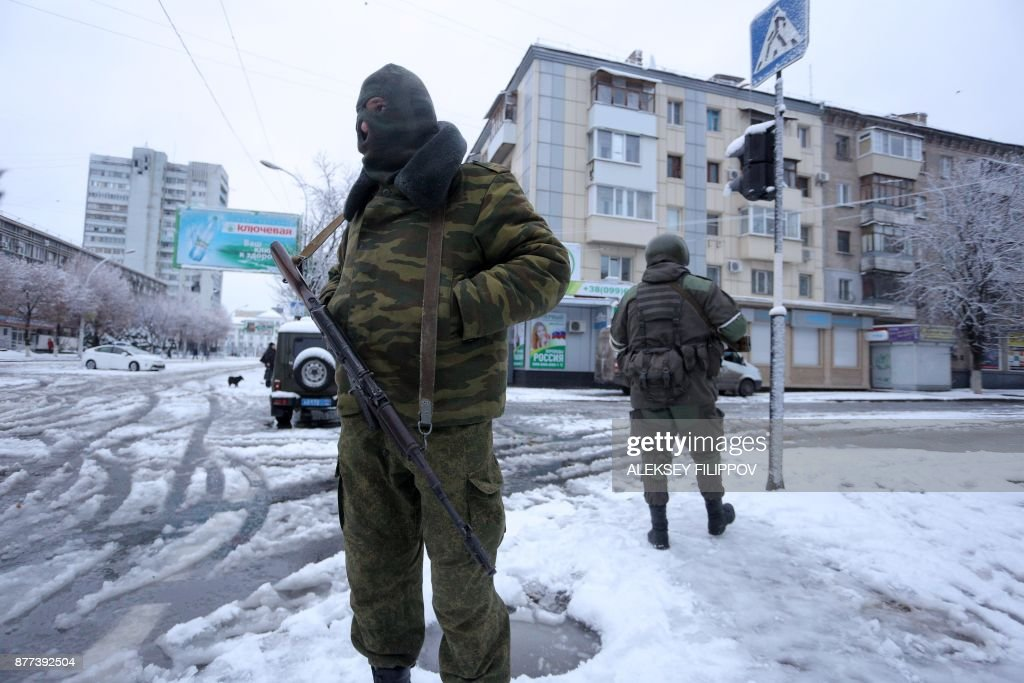 Hundreds of armed men in military fatigues on blocked access to government buildings in eastern Ukraine's rebel-held Lugansk