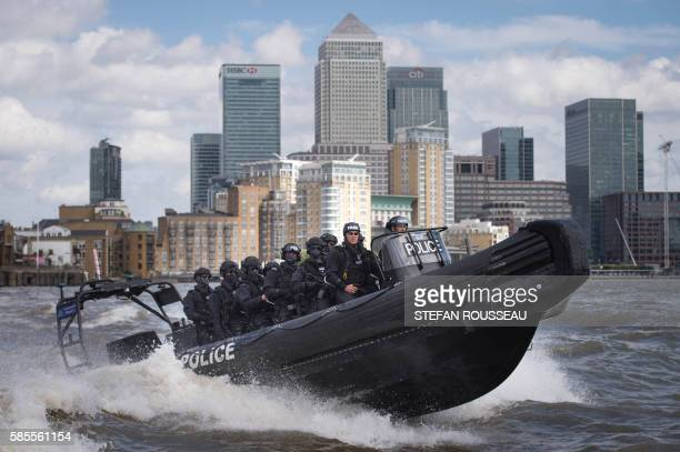 TOPSHOT Armed Metropolitan Police counter terrorism officers take part in an exercise on the River Thames in London on August 3 2016 Metropolitan...