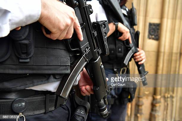 Armed Metropolitan Police officers patrol outside the Houses of Parliament on August 2 2016 in London England Security measures continue to be high...