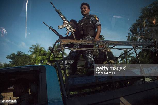 Armed military troops and police force travel in trucks through Maungdaw located in Rakhine State on October 14 2016 as the government announced that...