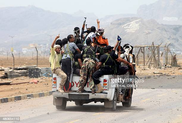 Armed militiamen loyal to Yemen's fugitive President Abderabbo Mansour Hadi drive in a pickup truck in the Khor Maskar neighbourhood of the southern...