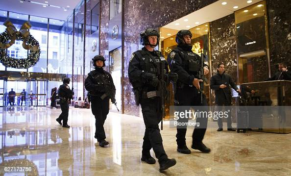 Armed New York City Police Department officers arrive at Trump Tower in New York US on Friday Dec 2 2016 Six years after the biggest overhaul of US...