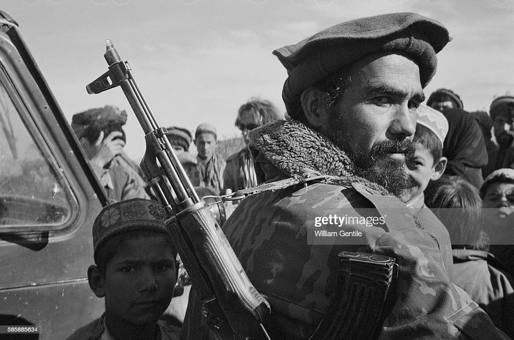 Armed Northern Alliance Fighters visit refugee camps near Khoja Bahauddin | Location Near Khoja Bahauddin Afghanistan