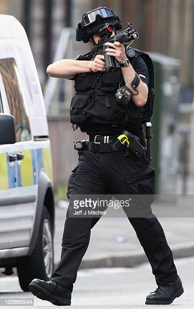 Armed officers attend an ongoing incident on Dumbarton Road on September 10 2010 in Glasgow Scotland Armed response units were called to a property...