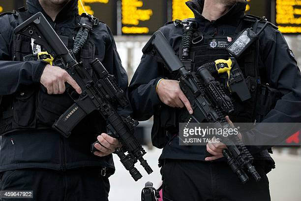 Armed officers from the British Transport Police patrol armed with LMT defender 556mm automatic rifles 9mm Glock pistols and tasers as part of...