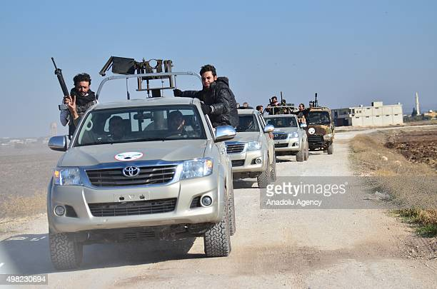 Armed opposition groups linked to the al Shamiya Front and Murat Brigades are seen in the village of Harcele seized after clashes with Daesh...