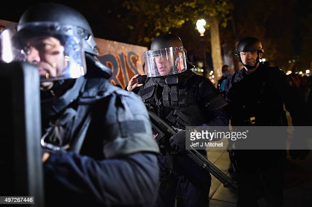Armed police are deployed in Place de la Republique during a false alarm incident on November 15 2015 in Paris France France is currently observing...