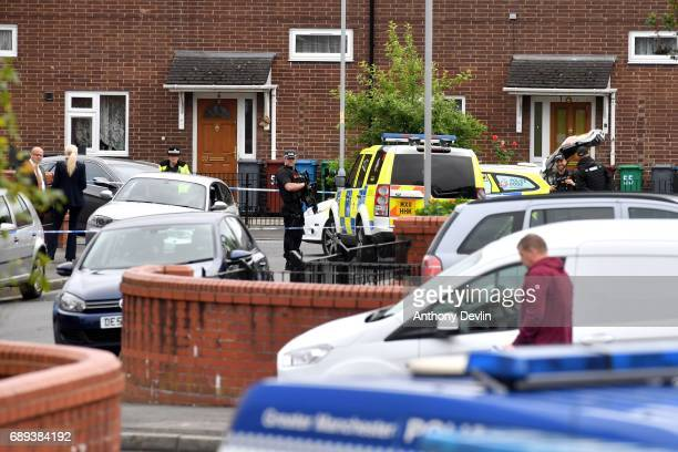 Armed police are seen outside a property on Quantock Street in the Moss Side area of Manchester where a raid was carried out earlier on May 28 2017...