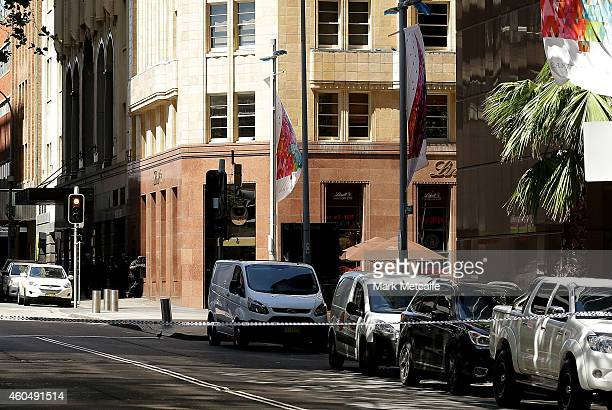 Armed police are seen outside the Lindt Cafe Martin Place on December 15 2014 in Sydney Australia Police attend a hostage situation at Lindt Cafe in...