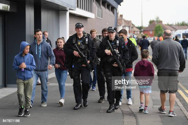 Armed police are seen outside the stadium prior to the Premier League match between West Bromwich Albion and West Ham United at The Hawthorns on...
