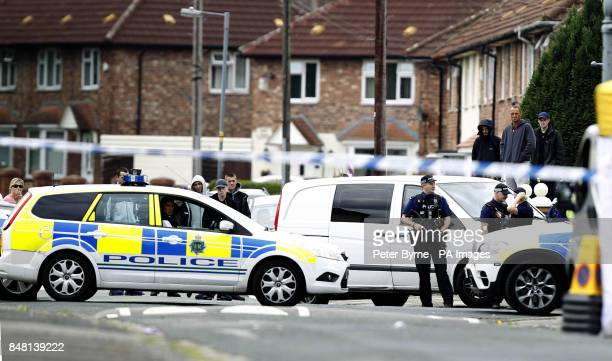 Armed police attend the scene in the Norris Green area of Liverpool after a man was shot dead