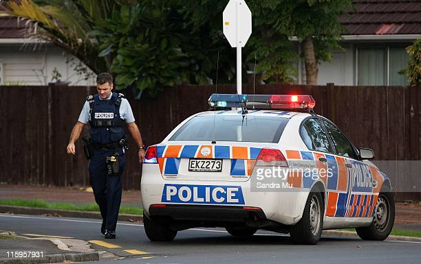Armed Police cordon off streets in Blockhouse Bay on June 13 2011 in Auckland New Zealand The Police are in search of an armed man in the area and...