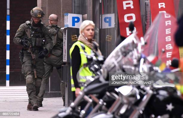 Armed police forces work at the scene where a truck crashed into the Ahlens department store at Drottninggatan in central Stockholm April 7 2017...