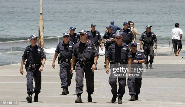Armed police from the New South Wales Special Operations Group patrol the esplanade of Cronulla Beach in Sydney 18 December 2005 The beachside suburb...