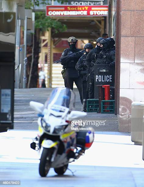 Armed police gather outside the Lindt Cafe Martin Place on December 15 2014 in Sydney Australia Police attend a hostage situation at Lindt Cafe in...