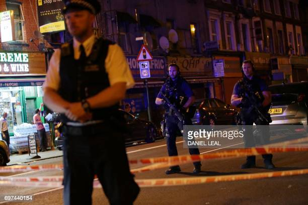 Armed police guard a street in the Finsbury Park area of north London where a vehichle hit pedestrians on June 19 2017 Several people are injured...
