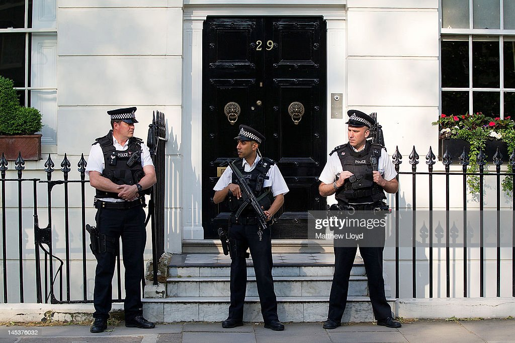 Armed police guard former Prime Minister Tony Blair's home as he leaves to appear at the Leveson Inquiry on May 28 2012 in London England The Inquiry...