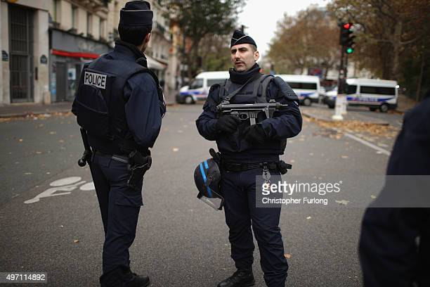 Armed police guard the Bataclan Theatre after yesterday's terrorist attack on November 14 2015 in Paris France At least 120 people have been killed...