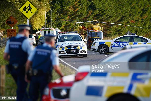 Armed police man a roadblock outside a property in Kawerau on March 9 2016 in Rotorua New Zealand Four police officers were shot and injured earlier...