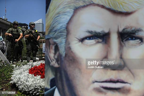 Armed police officer stand watch in Cleveland Public Square on July 19 2016 in Cleveland Ohio Protests are continuing outside on day two of the...