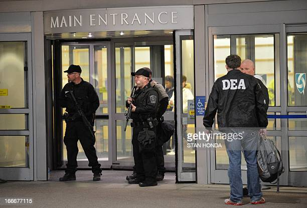 Armed police officers and Drug Enforcement Agency agents secure the main entrance to Brigham and Women's Hospital April 15 2013 in Boston...