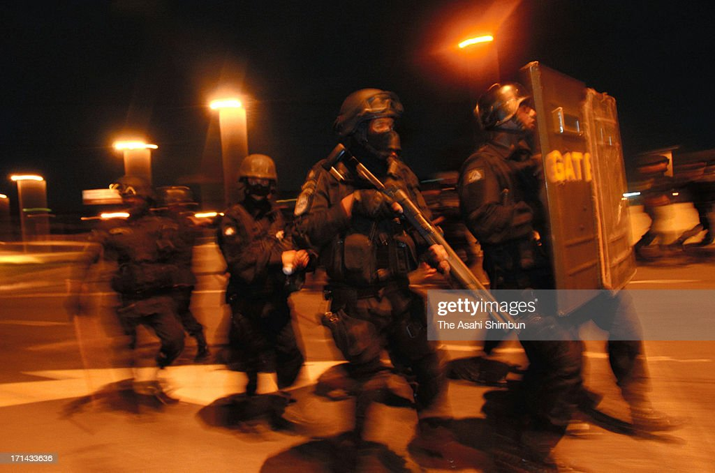 Armed police officers approach to protesters at one kilometers check point from Estadio Mineirao, on June 22, 2013 in Belo Horizonte, Brazil. 60,000 protesters gather and 12 injured.