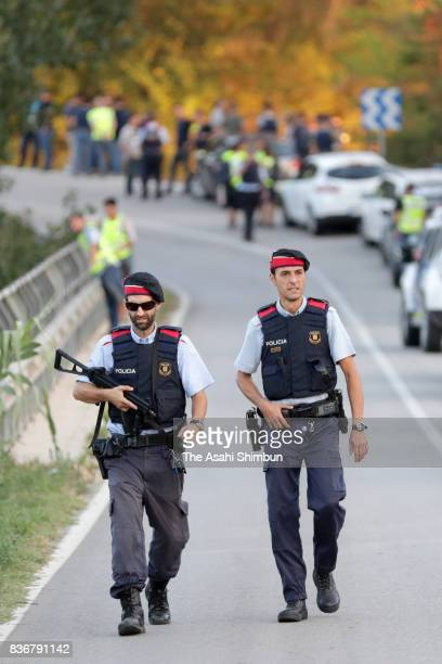 Armed police officers are seen at the site where Barcelona terror attack suspect Younes Abouyaaqoub was shot dead on August 21 2017 in Subirats Spain...