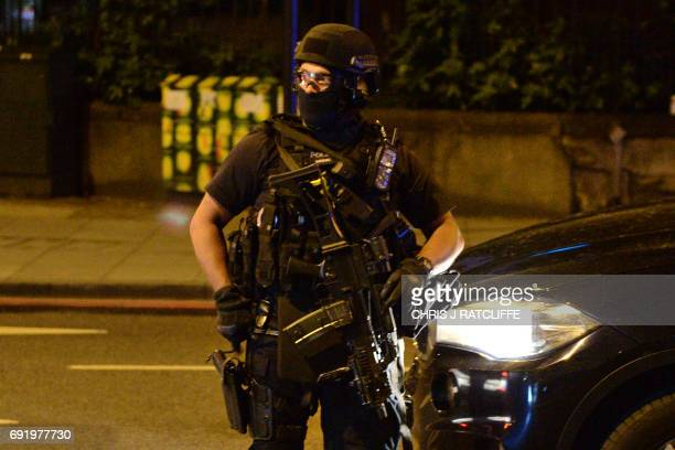 Armed police officers arrive at the scene of a terror attack on London Bridge in central London on June 3 2017 Armed police fired shots after reports...