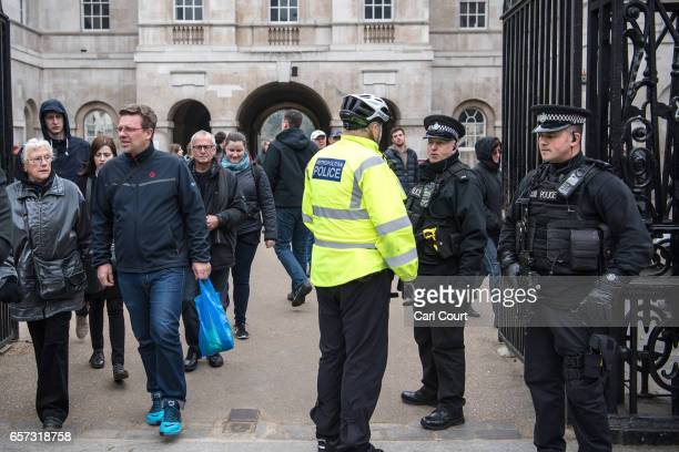 Armed police officers chat with a colleague at Horse Guards on March 24 2017 in London England A fourth person has died after Khalid Masood drove a...