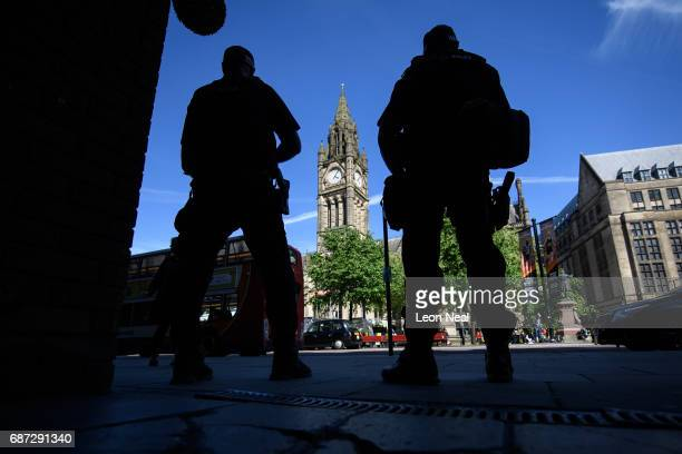 Armed police officers monitor the area before an evening vigil outside the Town Hall on May 23 2017 in Manchester England An explosion occurred at...