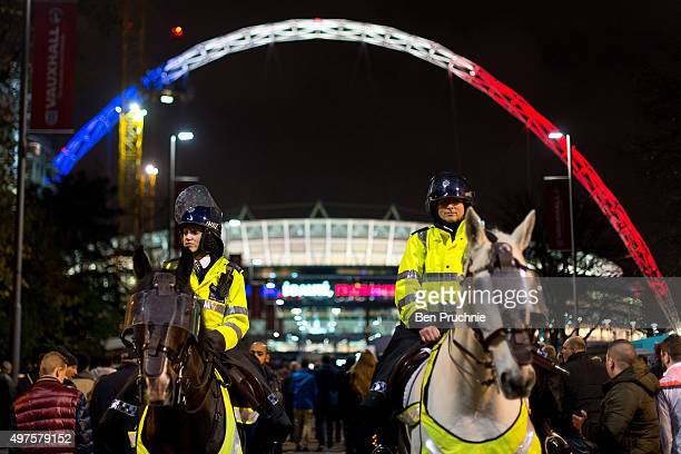 Armed Police officers on horseback stand guard outside Wembley Stadium ahead of tonight's International friendly match between England and France at...
