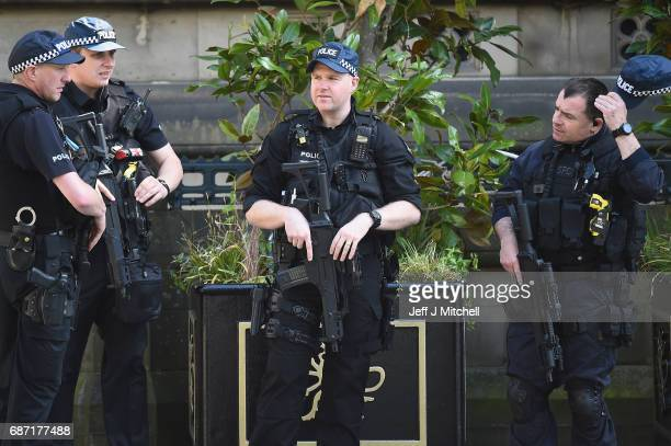 Armed police officers patrol Albert Square on Tuesday May 23 2017 in ManchesterEngland At least 22 people were killed in a suicide bombing at a pop...