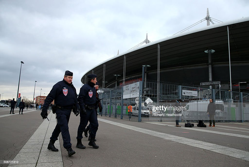 Armed police officers patrol around the outside perimeter of the stadium before the RBS Six Nations match between France and Italy at the Stade de France on February 6, 2016 in Paris, France.