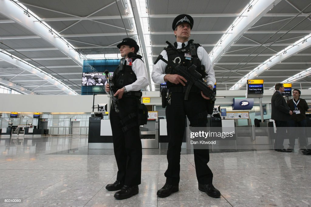 Armed police officers patrol the new Terminal 5 at Heathrow Airport prior to its official opening on March 14, 2008 in London, England. The £4.3 billion Terminal, built to accomate extra passenger capacity, will be opened today by Queen Elizabeth II despite having been the focus of considerable protest from environmental and residential groups.
