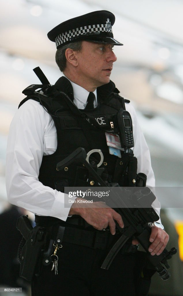 Armed police officers patrol the new Terminal 5 at Heathrow Airport prior to its official opening on March 14, 2008 in London, England. Following yesterday's major breach of security when an environmental protestor scaled the perimeter fence onto a runway; disprupting flights at the airport, security has been tightly stepped up in advance of the official unveiling of the new terminal by Queen Elizabeth II today.