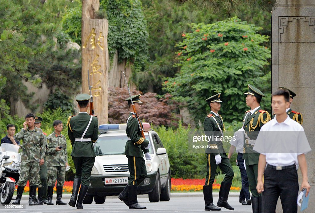 Armed police officers stand guard at the Diaoyutai State Guesthouse in Beijing on May 31, 2016, where Ri Su Yong, vice chairman of North Korea's ruling Workers' Party of Korea, made a surprise visit the same day.