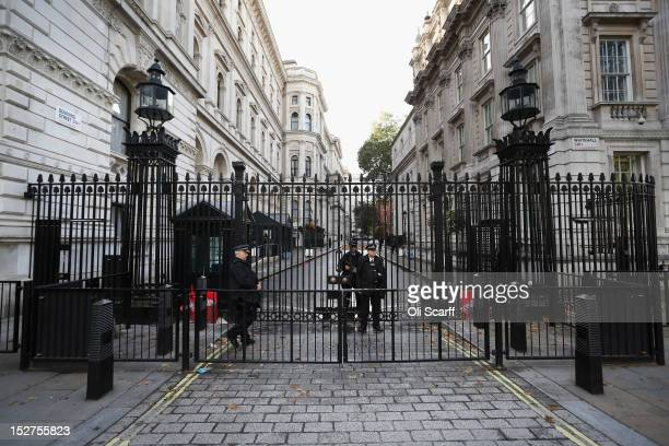 Armed police officers stand guard at the gates to Downing Street on September 25 2012 in London England Chief Whip Andrew Mitchell has apologised...