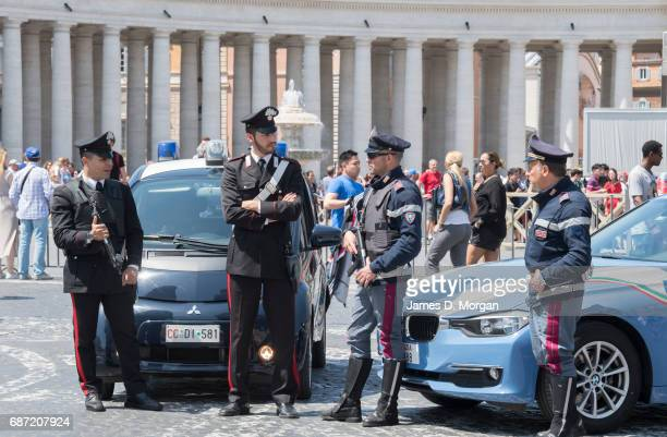 Armed police officers stand guard inside St Mark's Square near the Vatican on May 23 2017 in Vatican City Vatican Security is on its highest level as...